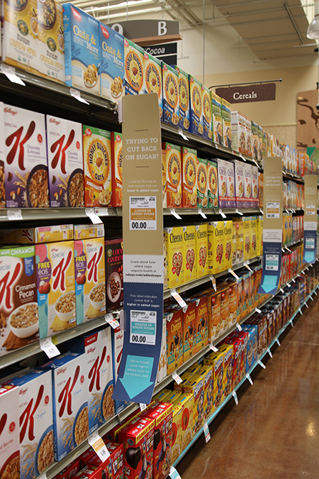 Raleys_added_sugar_signage_cereal_aisle.png