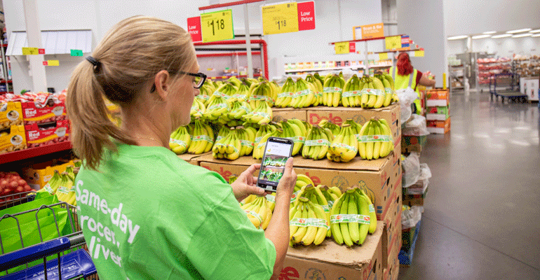 Sams_Club_Instacart_shopper_with_smartphone.png