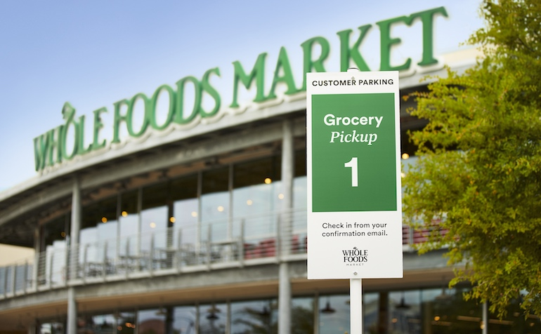 Whole Foods curbside pickup sign.jpg