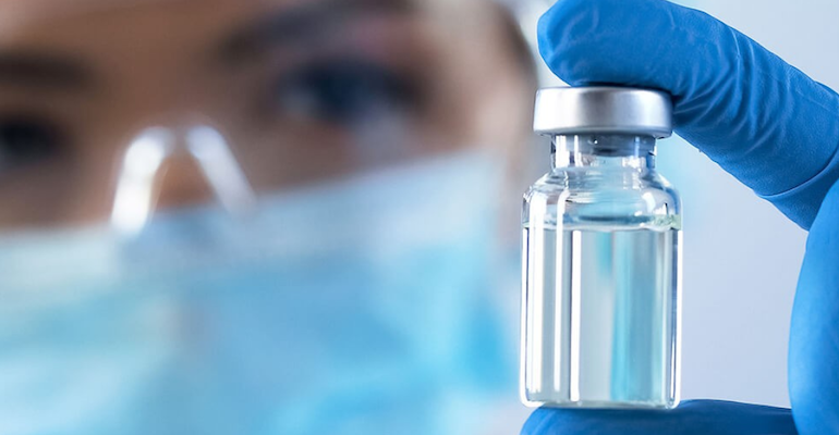 Albertsons-COVID_vaccine_vial-pharmacist.png