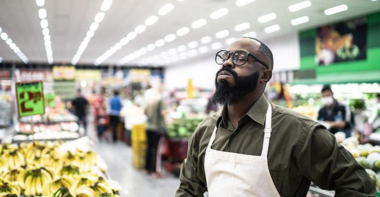 Axonify-study-worried-supermarket-employee.jpg