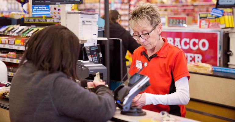 Grocery customer paying at checkout