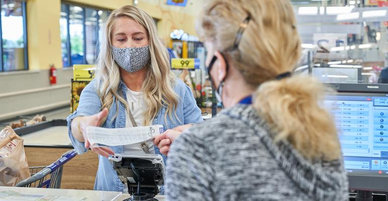 Kroger customer with face mask-checkout.jpg