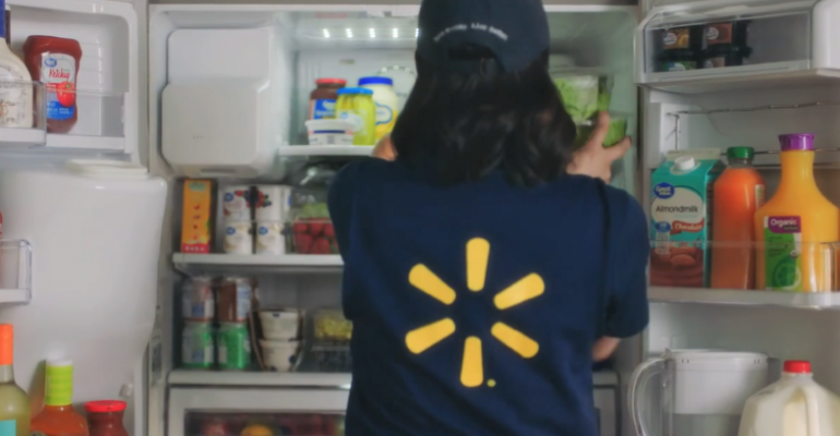 Walmart InHome Delivery associate_stocking fridge - Copy.PNG