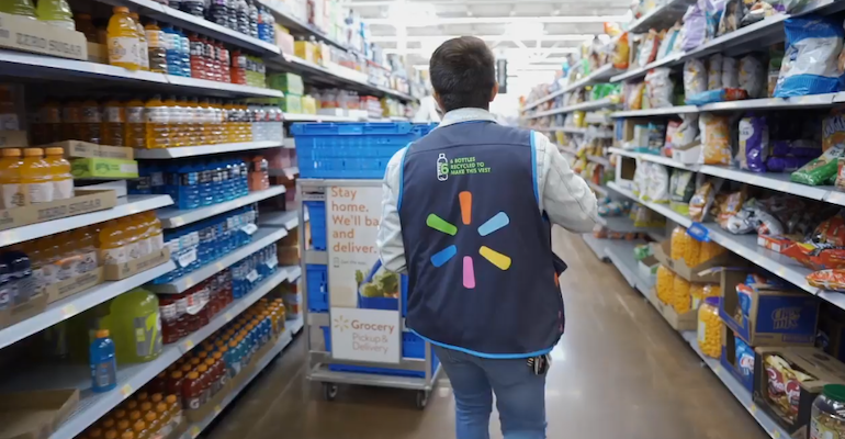 Walmart online grocery worker with cart
