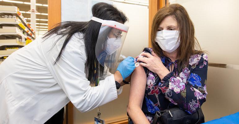 Walmart_Canada-pharmacist-COVID_vaccine.jpg