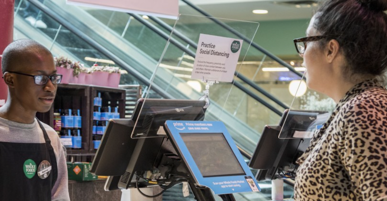 Whole Foods Market-plexiglass shield at checkout-coronavirus