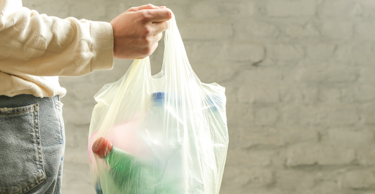 Woman-plastic-bag-single-use-plastic-waste.png