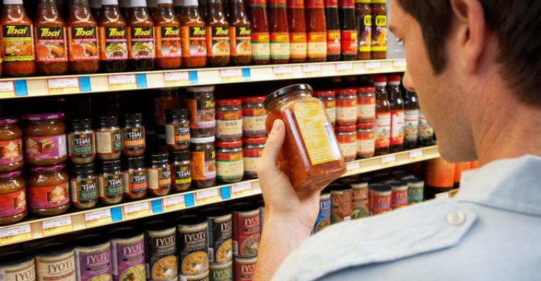 man-checking-labels-at-grocery-store_2.txt.jpeg