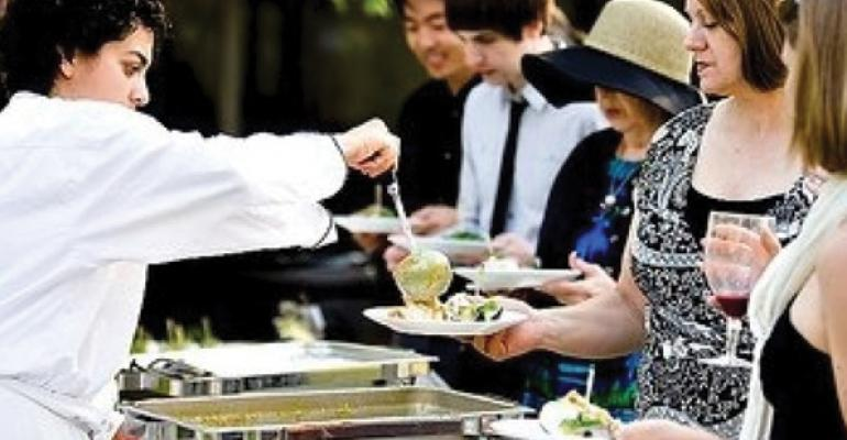 Renata Dos Santos founder of LIME serves guests at a recent event