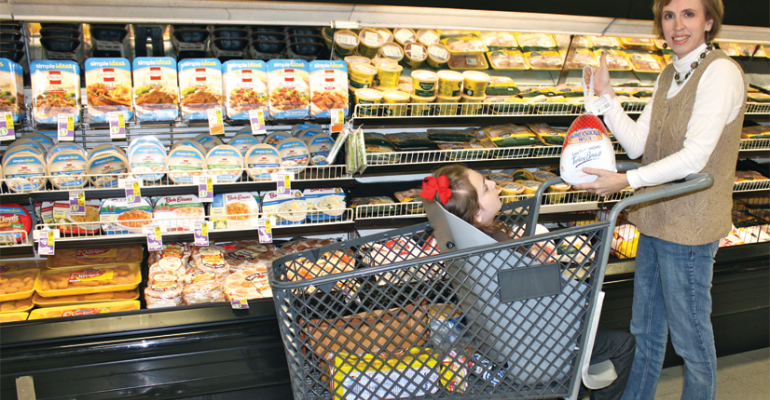Drew Ann Long takes her daughter shopping in Caroline39s Cart designed for specialneeds children