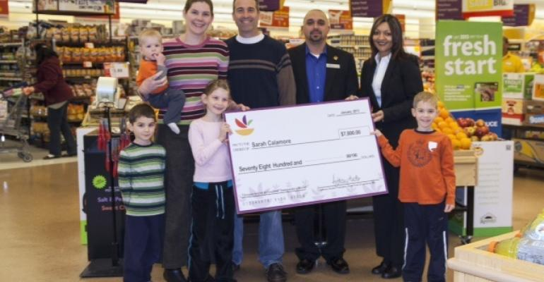 Scott Belcher store manager of Giant39s Stone Road store in Centreville Va third from right and Felis Andrade director of marketing and external communications for Giant Food present winner Sarah Calamore and her family with the prize