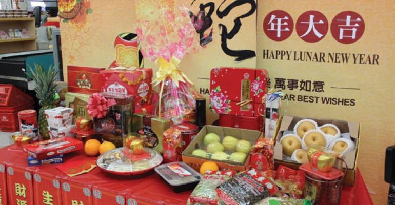 Traditional Lunar New Year gifts and foods are displayed at the front of stores