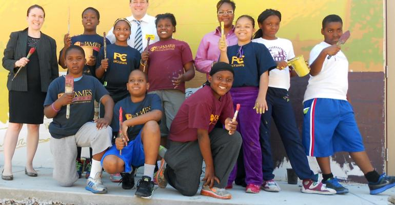 These Saint James Middle School students worked on the mural at a ShopRite that39s opening in Philadelphia39s Nicetown neighborhood Store owner Jeffrey Brown is at rear