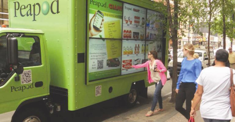 Shoppers use their smartphones to place their orders from the mobile billboards
