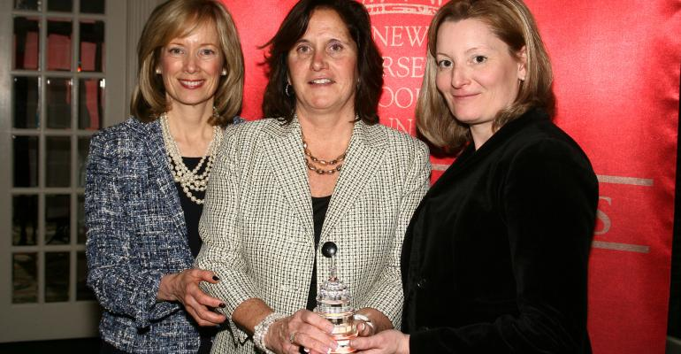 Linda Doherty center accepts the GMA Government Affairs Award from Judy Spires left and Mandy Hagan