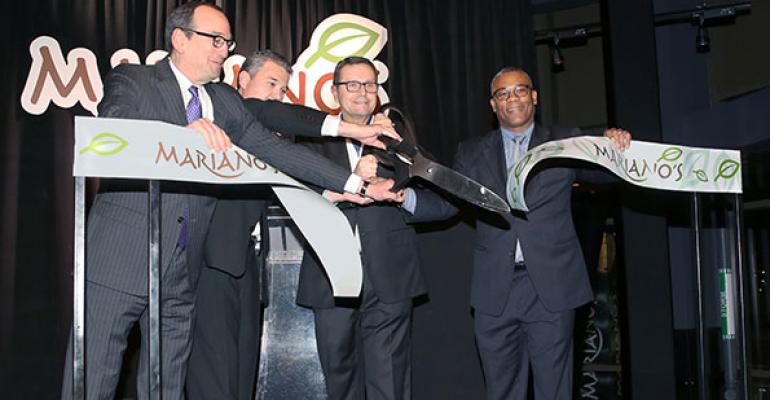 A ribboncutting ceremony officially opens the new Mariano39s store in the NewCity development Tuesday