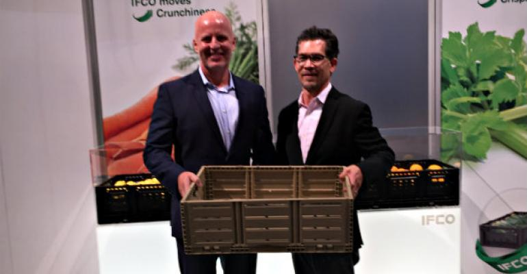 Dan Walsh president of IFCO North America and Dorn Wenninger Walmart39s VP of produce show a wood look RPC