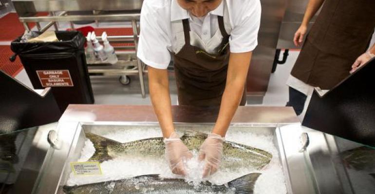 A New Seasons Market employee prepares sustainably raised seafood