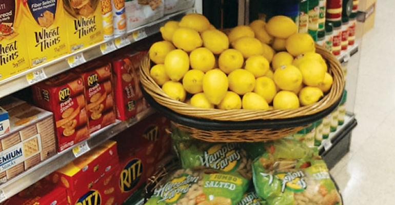 Merchandising produce away from the crowd