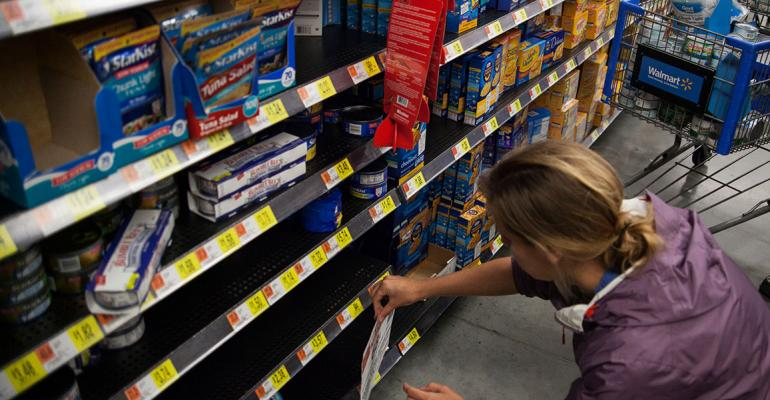 Greenpeace activists affixed signs to Walmart shelves after emptying them of tuna Photo courtesy of Greenpeace