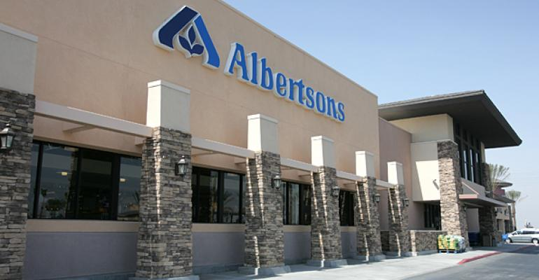 Albertsons sales tick up, loss narrows in 1Q