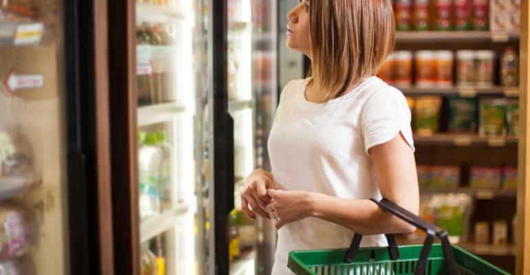 woman-shopping-freezer-case-with-basket.jpg
