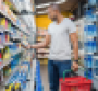 Supermarket shopper examines product from shelf
