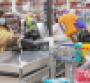 Walmart_shopper_at_checkout-COVID_copy_0.png