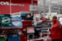 Target_checkout_worker-CVS_Pharmacy_sign.png