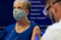 Walmart COVID19 vaccination-patient with pharmacist.png