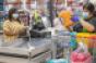 Walmart_shopper_at_checkout-COVID_copy.png