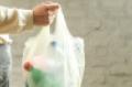 Woman-plastic-bag-single-use-plastic-waste.png