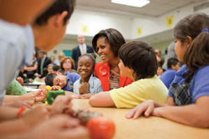 "First Lady Michelle Obama joins students for a ""Let's Move!"" Salad-Bars-to-Schools launch event, 2010."