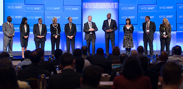 Greg Foran (sixth from left) and Walmart executives field analysts' questions.