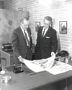 "Publix founder George Jenkins (left) consults with Bill Schroter, who coined the company's enduring corporate slogan, ""Where Shopping is a Pleasure."""