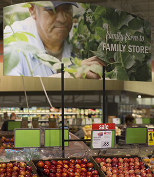 Retailers like Meijer use in-store signage to advertise local produce efforts.