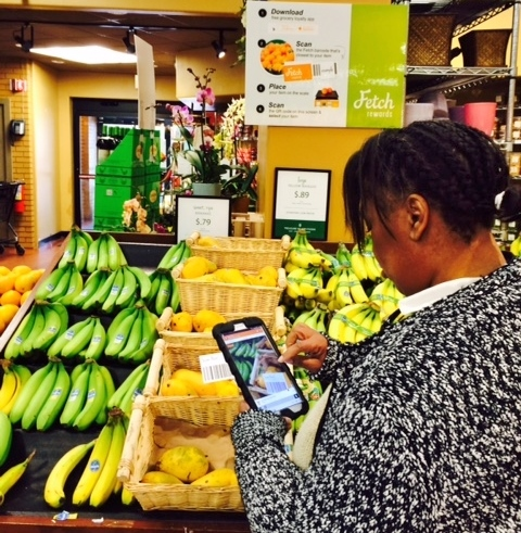 A shopper uses the Fetch Rewards app at Treasure Island in Chicago