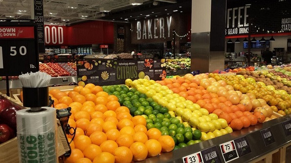 A large produce selection, dramatic signage and a Naturally Better health food section greet customers.