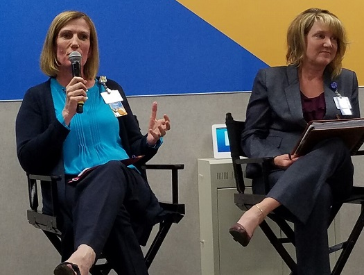 Pippa Pomeroy (left) and Michelle Knight discuss worker training and development initiatives at Walmart.
