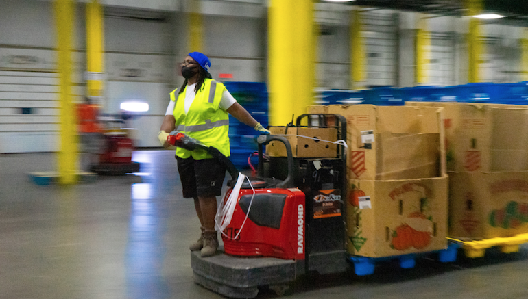 ADUSA_distribution_center_worker-Ahold_Delhaize_USA.png