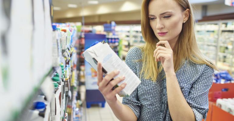 Woman reading mik label