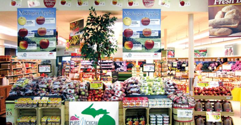 Plumbs Wins Local Michigan Apple Display Contest