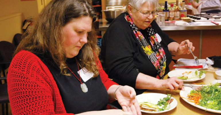 Students learn how to make sushi at a PCC Natural Markets cooking class