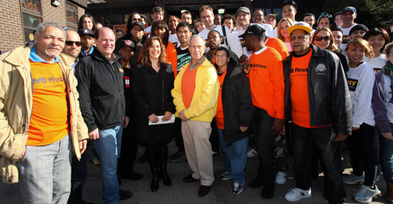Bill Sanford front row second from left president of Fairway Constance Costas principal of the marketing and business development firm Greenhill Agency and Mayor Bloomberg are surrounded by Fairway and NYC Restore volunteers