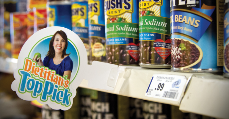 A photo of Alicia Jerome corporate dietitian for United Supermarkets adorns shelf talkers