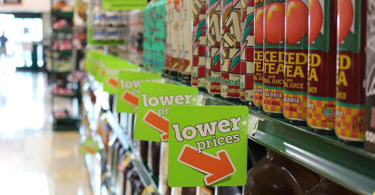 Green shelf tags call attention to items that have lower prices