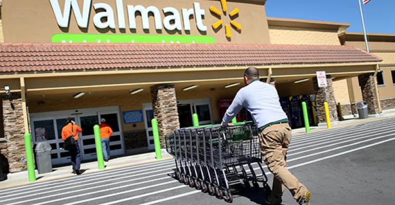 Walmart 2Q earnings dip, outlook trimmed