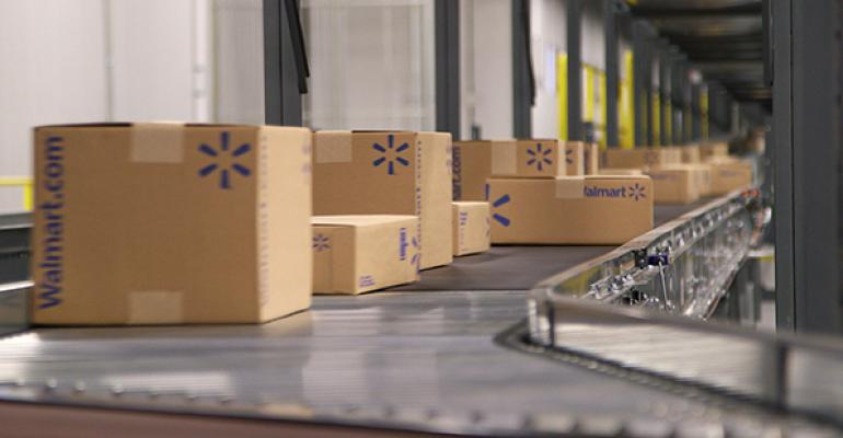 This shipping department conveyor belt stays busy at the Walmart ecommerce fulfillment center