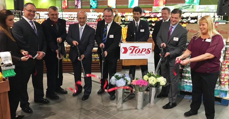Tops executives and local community leaders cut the ribbon to open the new store